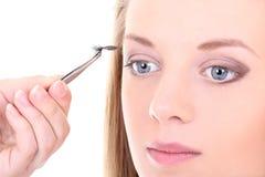 Kvinna med konstgjorda ögonfranser Royaltyfri Foto