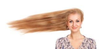 Kvinna med långt blåsa hår Arkivfoton