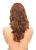 Kvinna med långt hår från baksidan royaltyfria foton