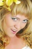Kvinna med liljan Arkivfoto