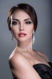 Kvinna med ljus makeup Fotografering för Bildbyråer