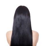 Kvinna med long rakt brunt hår Arkivbild
