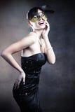 Kvinna med maskeringen Royaltyfria Foton