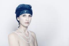 Kvinna med pärlor Royaltyfria Bilder