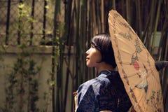 Kvinna med paraplyet Royaltyfria Foton