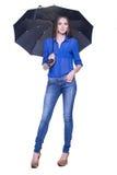 Kvinna med paraplyet mot vit bakgrund Royaltyfri Bild