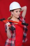 Kvinna med pincers Fotografering för Bildbyråer