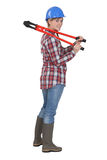 Kvinna med röda bultsaxar Arkivfoto