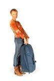 Kvinna med resväskan Arkivfoto