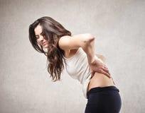 Kvinna med ryggvärk Royaltyfria Foton