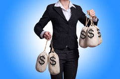 Kvinna med säckar av pengar Royaltyfri Fotografi