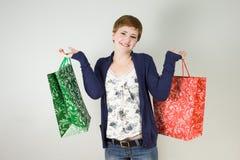 Kvinna med shoppingpåsar Royaltyfri Fotografi