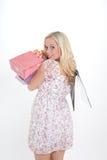 Kvinna med shoppingpåsar Arkivbild