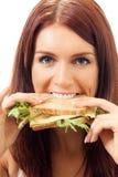 Kvinna med smörgåsen royaltyfri bild