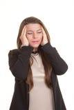 Kvinna med spänningshuvudvärk Arkivbild