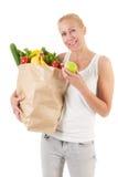Kvinna med sunda grönsaker och frukt Fotografering för Bildbyråer