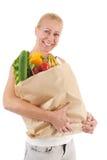 Kvinna med sunda grönsaker och frukt Arkivfoton
