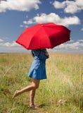 Kvinna med sunparaplyet royaltyfria foton