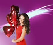Kvinna med valentinbaloons Royaltyfri Foto