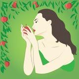 Kvinna och äpple Arkivbild
