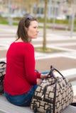 Kvinna och bagage royaltyfria foton