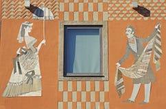 Kvinna och en man - freskomålning på fasad Arkivbilder