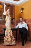 Kvinna och man under Feria de Abril på April Spain Royaltyfri Foto
