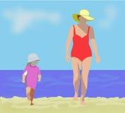 Kvinna och småbarn på stranden Fotografering för Bildbyråer