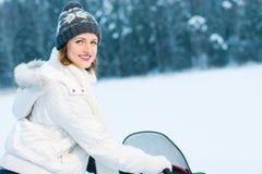 Kvinna och snowmobile Royaltyfri Foto