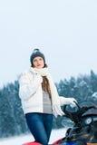 Kvinna och snowmobile Arkivfoton