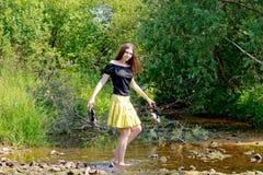 Kvinna och ström Fotografering för Bildbyråer