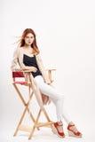 Kvinna på en hög stol, mode arkivfoto