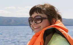 Kvinna på en yacht Fotografering för Bildbyråer