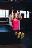 Kvinna på gymnastiska cirklar royaltyfri fotografi