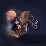Kvinna på motorcykeln Arkivbild