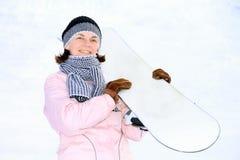Kvinna på snowboard Royaltyfri Foto