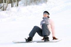 Kvinna på snowboard Royaltyfria Foton