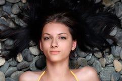 Kvinna på stenar Royaltyfria Foton