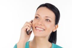 Kvinna på telefonen. Arkivbild