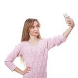 Kvinna som använder app på den smarta telefonen royaltyfria foton