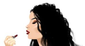 Kvinna som applicerar läppstift Fotografering för Bildbyråer