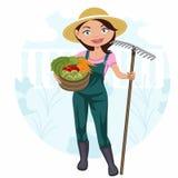 Kvinna som arbetar i grönsakträdgården Arkivbilder