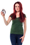 Kvinna som att glo på hennes ringklocka fotografering för bildbyråer