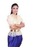 Kvinna som bär den typiska thai klänningen Arkivfoton