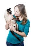 Kvinna som berättar av katt arkivfoton