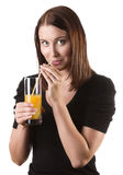 Kvinna som dricker orange fruktsaft Royaltyfri Fotografi