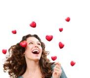Kvinna som fångar Valentine Hearts Arkivbilder
