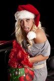 Kvinna som fångas av bilen med gåvor Royaltyfri Foto