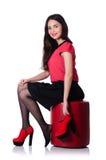 Kvinna som försöker isolerade nya skor Fotografering för Bildbyråer