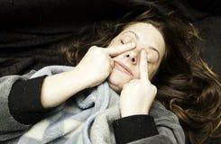 Kvinna som gör horn Fotografering för Bildbyråer